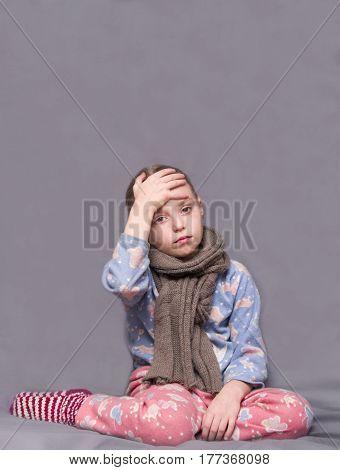 Sick little girl. Headache cold at home