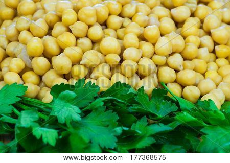 Parsley and chickpeas close-up. Texture of cooked chickpeas and fresh parsley
