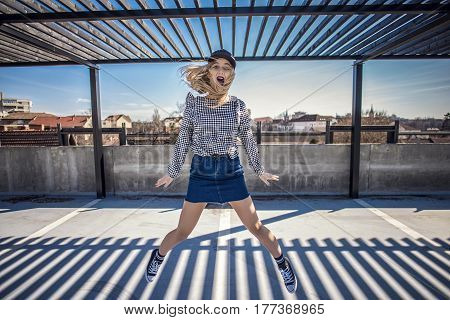 Happy Woman Jumping In Her Classic Sneakers