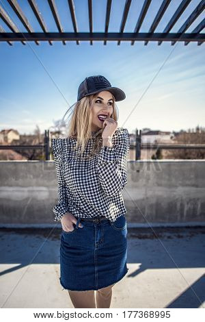 Portrait Of Fashion Woman Wearing Checkered Shirt And Leather Cap