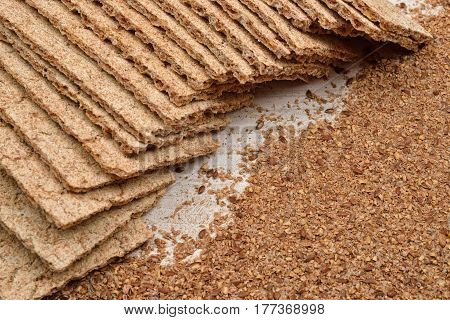 Dry Diet Crisp Breads And Integral Wheat Flour On Wooden Background. From Raw Material To The Finish