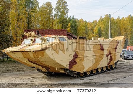 Nizhniy Tagil Russia - September 25. 2013: Tracked amphibious carrier PTS-4 move on the demonstration range. RAE-2013 exhibition