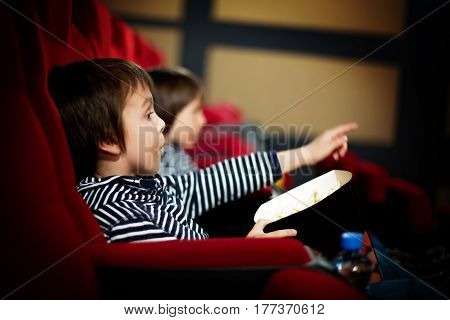 Two Preschool Children, Twin Brothers, Watching Movie In The Cinema