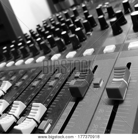 Audio sound mixer&amplifier equipment sound acoustic musical mixing&engineering concept background selective focus black&white