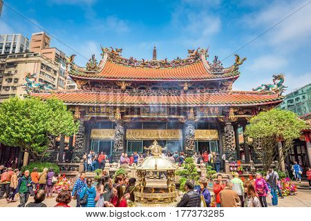 TAIPEI, TAIWAN - MARCH 18, 2017: Crowds at Lungshan Temple of Manka. The landmark temple dates from 1738.