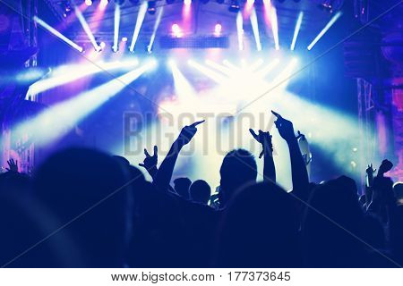 Crowd With Arms Outstretched At Concert