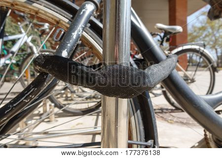 Bicycles parked with safe chain, focus on foreground