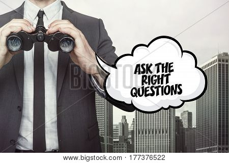 Ask the right questions text on  blackboard with businessman and key
