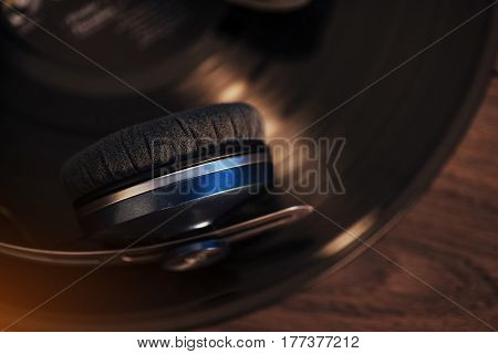 Vinyl Record And Headphone Over Wooden Table. Audio Enthusiast,music Lover Or Professional Disc Jock