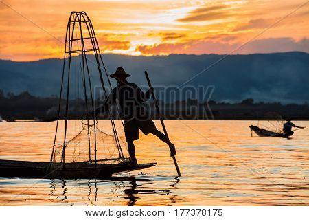 INLE LAKE, MYANMAR - DECEMBER 09, 2016 : Fisherman fishing at sunset on the Inle Lake Shan state in Myanmar