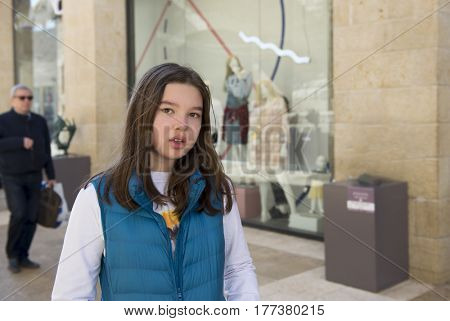 Teen girl in the street of Jerusalem, Israel. Street photo