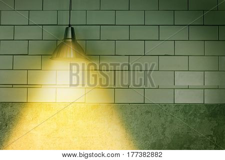 ceiling light lamp on dark wall with copy space.