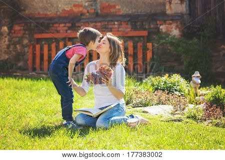 Cute Little Boy, Giving Present To His Mom For Mothers Day In The Garden