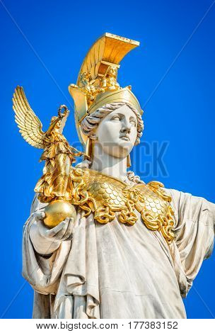 Vienna Austria. Austrian Parliament with the statue of Pallas Athena of the greek goddess of wisdom. Wien.