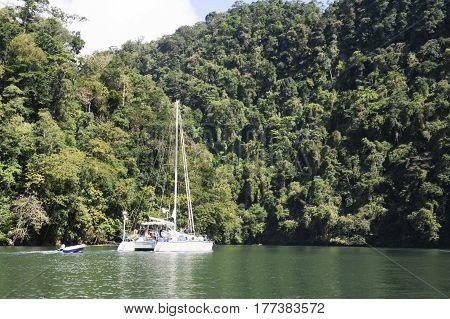River Dulce, Guatemala - 21 January 2014: Sailing boat on river Dulce near Livingston on Guatemala