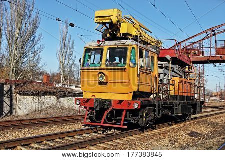 Orange Railway track service car fixing and repairing the railroad.