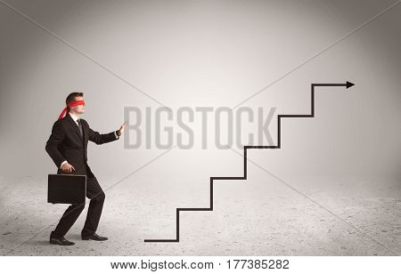 A male office worker standing blindfolded and confused with arrows pointing in different directions concept