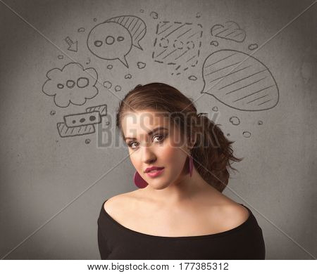 A cute female student making funny expressions with thoughts in her head illustrated by drawn chat bubbles on the urban wall background concept.