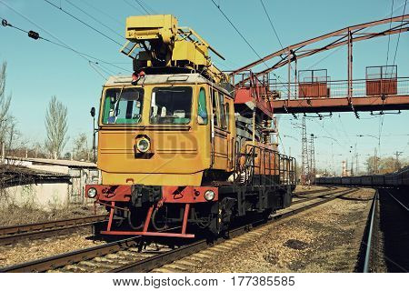 Yellow Railway track service car fixing and repairing the railroad.