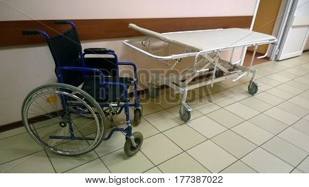 Wheelchair and medical bed in an old medical facility