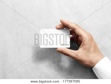 Hand hold blank white loyalty card mockup with rounded corners. Plain vip mock up template holding arm. Plastic discount namecard display front. Gift offset card design. Loyal service branding. poster