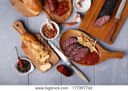 Snack set. Variety of salami cheese chechil and bread. Rustic style. Top view.