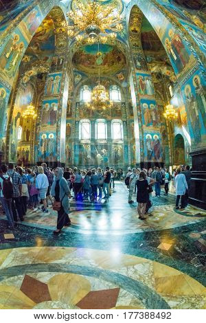 Church Of The Savior On Spilled Blood. Tourists And Parishioners Crowded Under The Arches Of The Tem