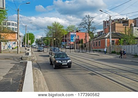 Dnipro Ukraine - April 19 2016: Small city street with tram tracks in early spring early in the evening