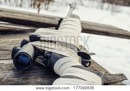Pneumatic rifle with an optical sight for sport hunting