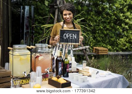 Adult Women with Beverage at Food Stall Market with Open Sign