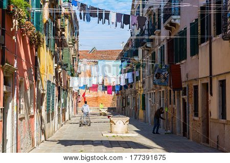Typical Alley With Clotheslines In Venice, Italy