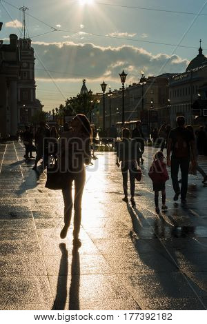 ST. PETERSBURG RUSSIA - JULY 15 2016: Nevsky prospect typical street scene with people walking along the avenue in Saint Petersburg Russia