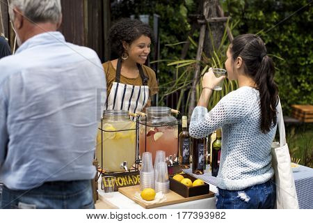 Adult Women Selling Lemonade to Customer at Food Stall Market