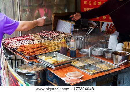 Tai O Hong Kong - March 13 2017: scene at a cook shop in Tai O. Tai O is a popular traditional fishing village on Lantau Island famous for its unique stilt houses