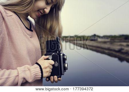 Woman wanderlust with vintage retro camera