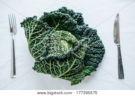 Fresh Green Kale Most Useful Vegetables On White Background With A Fork And Knife
