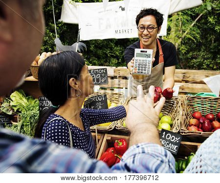 Man Selling Fresh Local Vegetable at Farmers Market