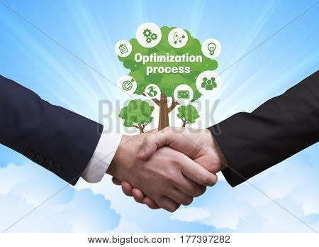 Technology, The Internet, Business And Network Concept. Businessmen Shake Hands: Optimization Proces