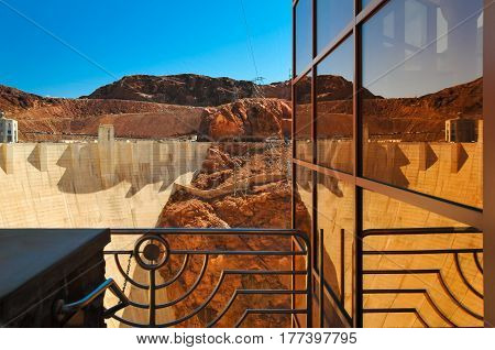 A reflection of the Hoover Dam in the window
