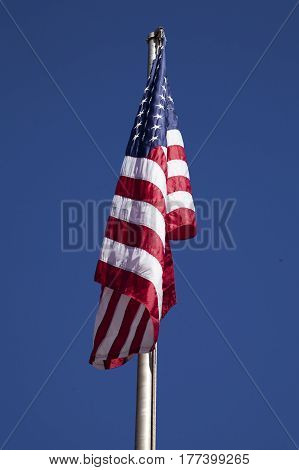 The American flag on a blue sky background