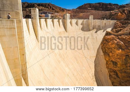 A person standing by the Hoover Dam