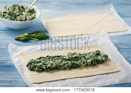 Puff pastry rolls  with spinach and ricotta. Cooking process.