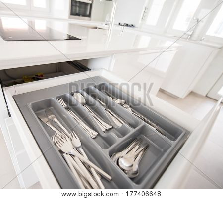 Opening drawer for Silver cutlery, focus on kitchenware
