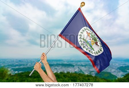 Young man's hands proudly waving the Belize national flag in the sky, part 3D rendering