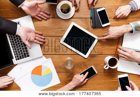 Business people meeting crop background top view with copy space on tablet. Wooden workspace