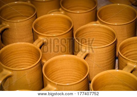 A collection brown homemade of clay cups