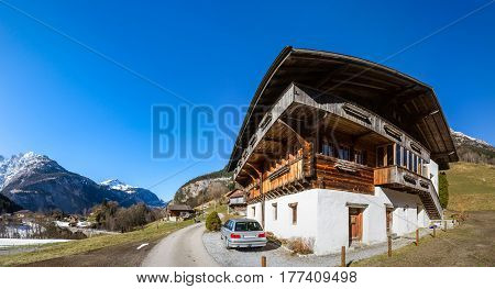 Typical Alpine House. Switzerland. Wide-angle Hd-quality Panoramic View.