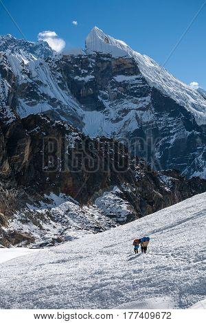 Porters Crossing Cho La Pass In Everest Region, Nepal