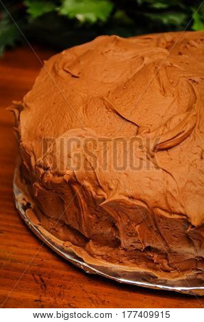 A chocolate frosted birthday cake ready to eat