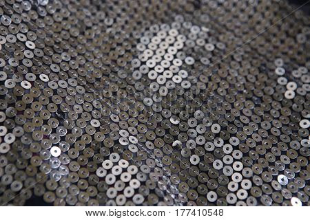 Mirror spangles background. Shiny mirrored fashion fabric.
